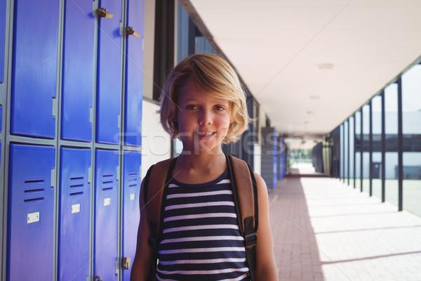 Portré mosolyog fiú áll folyosó iskola Stock fotó © wavebreak_media