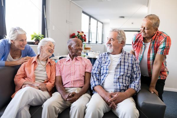 Mosolyog idős barátok hallgat férfi ül Stock fotó © wavebreak_media