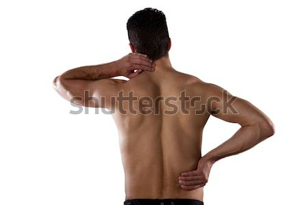 Rear view of shirtless sportsperson suffering from pain Stock photo © wavebreak_media