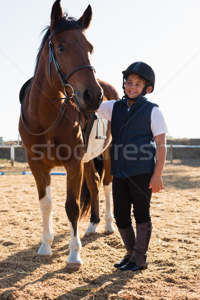 Rider boy caressing a horse in the ranch Stock photo © wavebreak_media