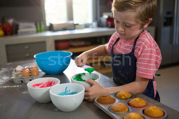 Boy mixing green batter Stock photo © wavebreak_media