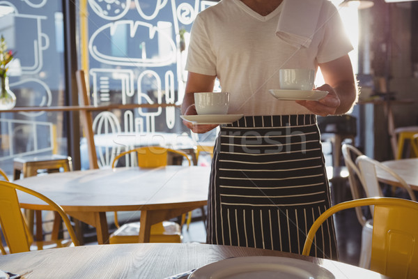 Mid section of waiter holding coffee cups Stock photo © wavebreak_media