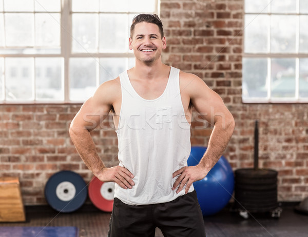 Smiling muscular man with hands on hips Stock photo © wavebreak_media