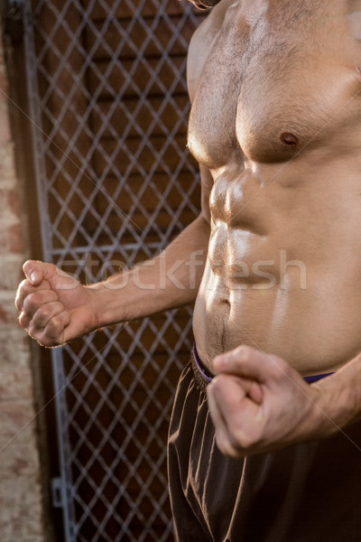 Midsection of man with clenched fist Stock photo © wavebreak_media