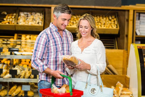 Sorridere Coppia acquisto pane supermercato business Foto d'archivio © wavebreak_media