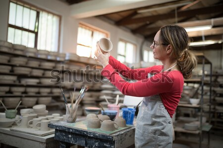 Attentive female potter painting bowl Stock photo © wavebreak_media