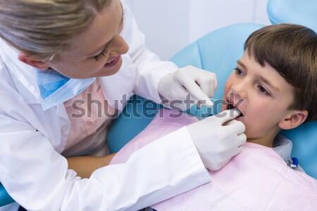 Dentist examining patient at medical clinic Stock photo © wavebreak_media
