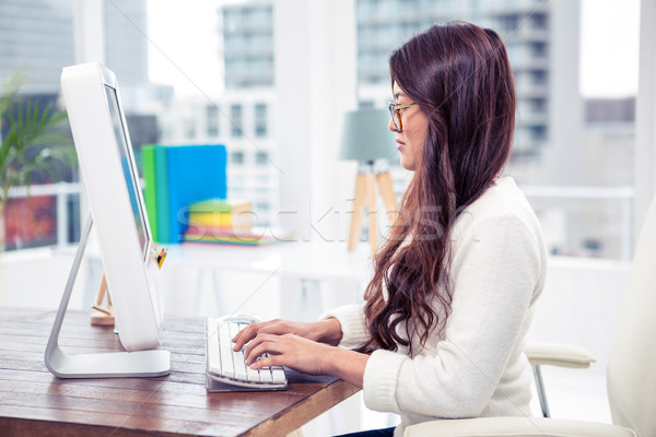 Focused Asian woman on computer Stock photo © wavebreak_media
