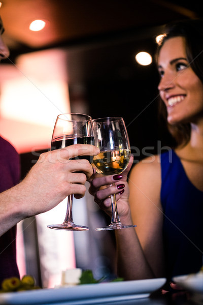 Couple toasting with a glass of wine Stock photo © wavebreak_media