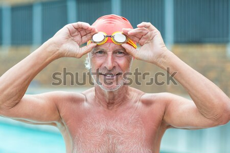 Bel homme nager cap lunettes piscine Photo stock © wavebreak_media