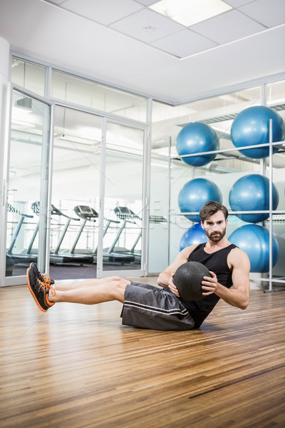 Man doing exercise with medicine ball Stock photo © wavebreak_media