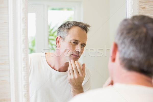 Yakışıklı adam bakıyor ayna banyo adam ev Stok fotoğraf © wavebreak_media