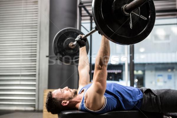 筋肉の 男 ベンチ バーベル crossfitの ストックフォト © wavebreak_media