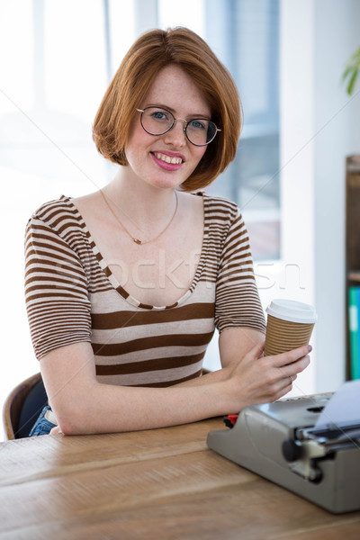 smiling hipster woman with a coffee cup Stock photo © wavebreak_media