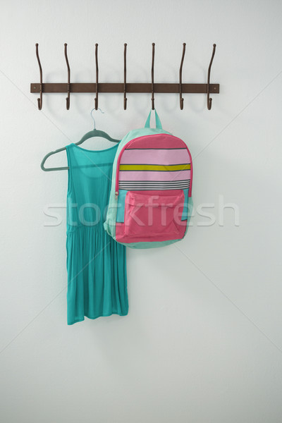 Turquoise dress and school bag hanging on hook Stock photo © wavebreak_media