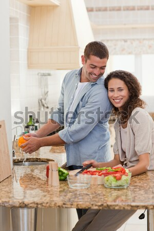 Couple chopping vegetables to prepare salad in the kitchen Stock photo © wavebreak_media