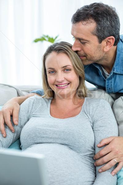 Couple sitting together on sofa Stock photo © wavebreak_media