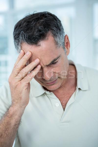 Homem preocupado algo em pé janela casa Foto stock © wavebreak_media