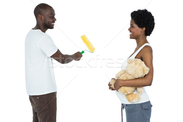 Pregnant couple painting with paint roller Stock photo © wavebreak_media