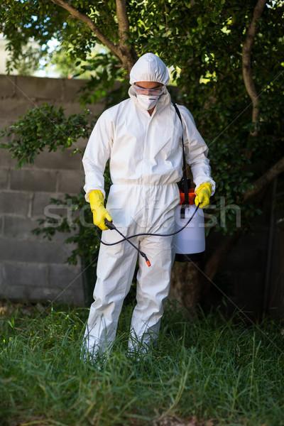 Man spraying pesticide on grass Stock photo © wavebreak_media