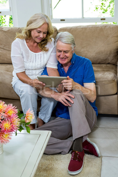 High angle view of senior couple using digital tablet in living  Stock photo © wavebreak_media
