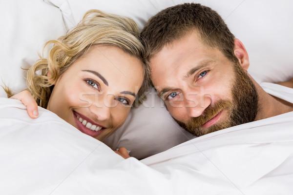 Portrait of couple smiling on bed Stock photo © wavebreak_media
