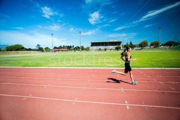 Female athlete running on the running track Stock photo © wavebreak_media