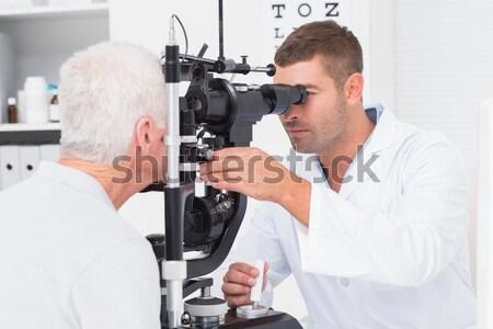 Női optometrikus megvizsgál fiatal beteg lámpa Stock fotó © wavebreak_media