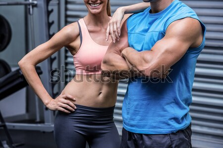 Midsection of female friends touching belly in gym Stock photo © wavebreak_media