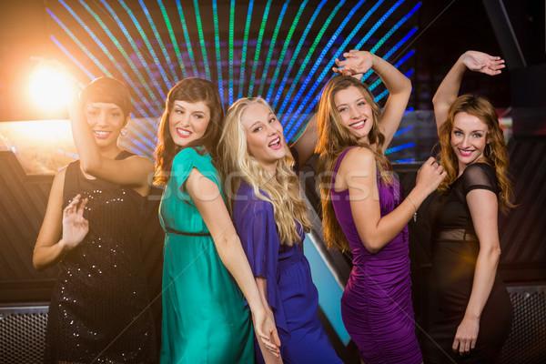 Groep glimlachend vrienden dansen dansvloer portret Stockfoto © wavebreak_media