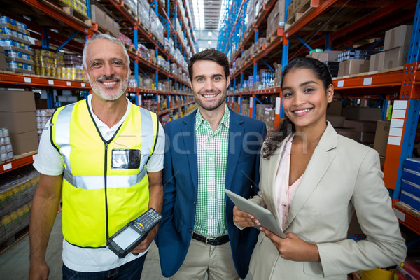 Portrait of warehouse team standing with digital tablet and barcode scanner Stock photo © wavebreak_media