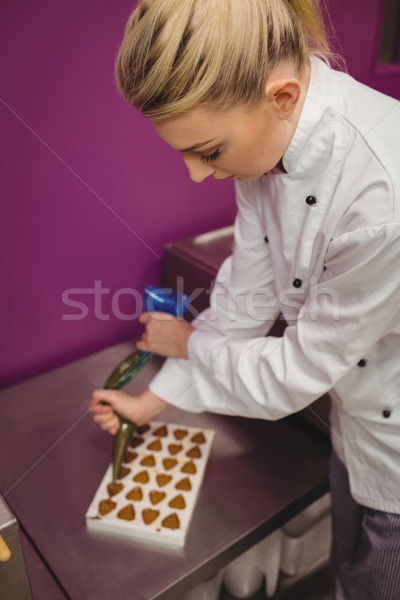 Worker filling mould with piping bag Stock photo © wavebreak_media