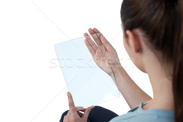 Businesswoman pretending to use digital tablet Stock photo © wavebreak_media