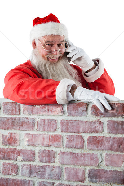 Kerstman permanente naast schoorsteen praten mobiele telefoon Stockfoto © wavebreak_media