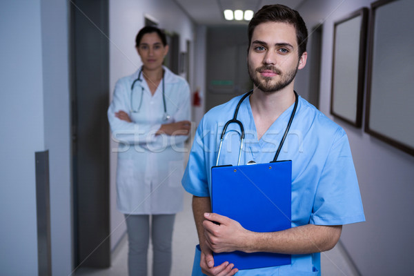 Portrait of male nurse standing with doctor in background Stock photo © wavebreak_media