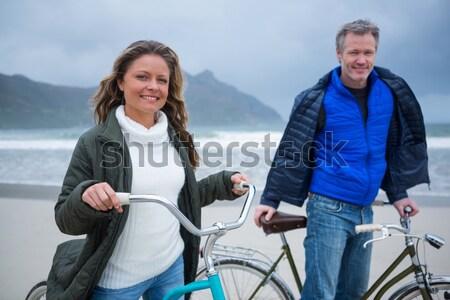 Maduro casal ciclismo praia mulher amor Foto stock © wavebreak_media