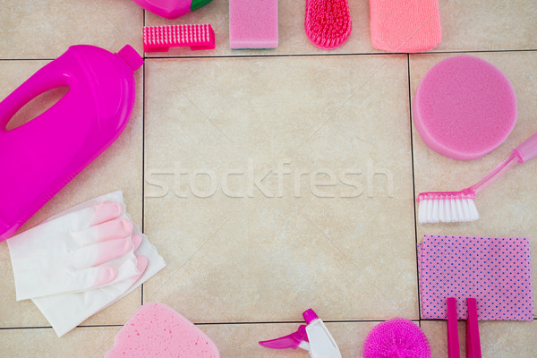 Cleaning products arranged on tiled floor Stock photo © wavebreak_media