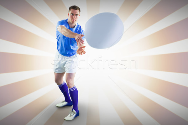 Composite image of rugby player throwing a rugby ball Stock photo © wavebreak_media