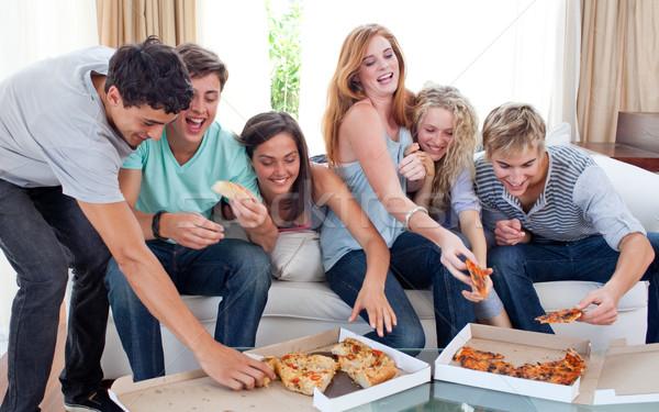 Friends eating pizza at home Stock photo © wavebreak_media