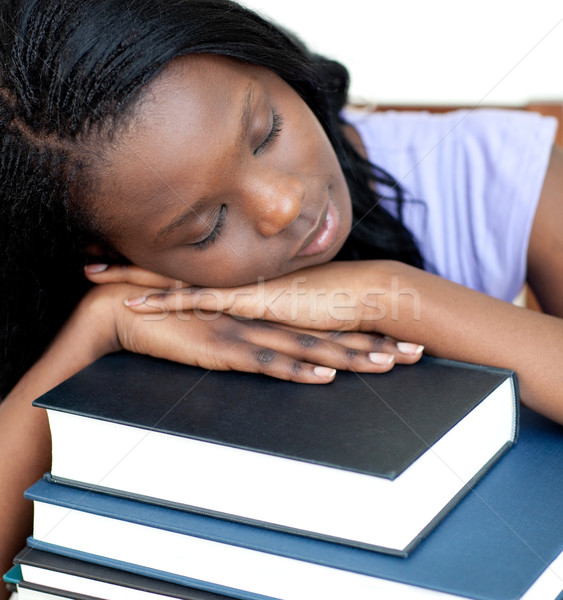 Exhausted student leaning on a stack of books  Stock photo © wavebreak_media