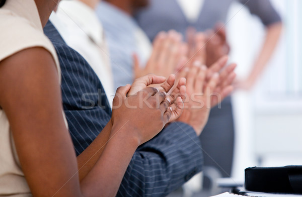 Ambitious business team applauding in a meeting Stock photo © wavebreak_media