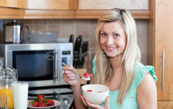 Attractive young woman having an healthy breakfast Stock photo © wavebreak_media