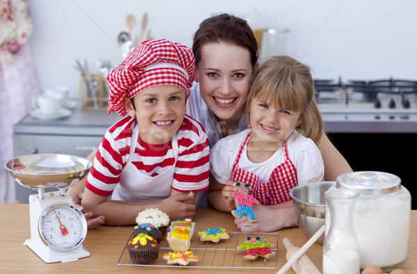 Woman and children baking in the kitchen Stock photo © wavebreak_media