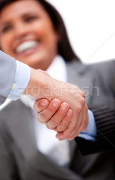 Smiling businesswoman looking at her partners shaking hands Stock photo © wavebreak_media