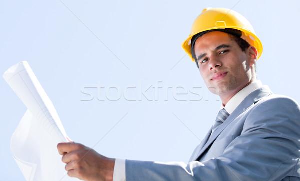 Smiling male architect holding a blueprint Stock photo © wavebreak_media