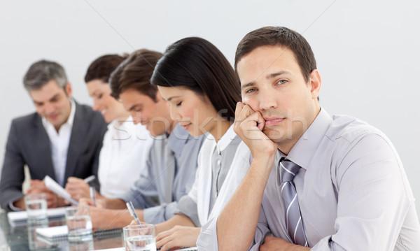 Vervelen zakenman vergadering team gelukkig pen Stockfoto © wavebreak_media