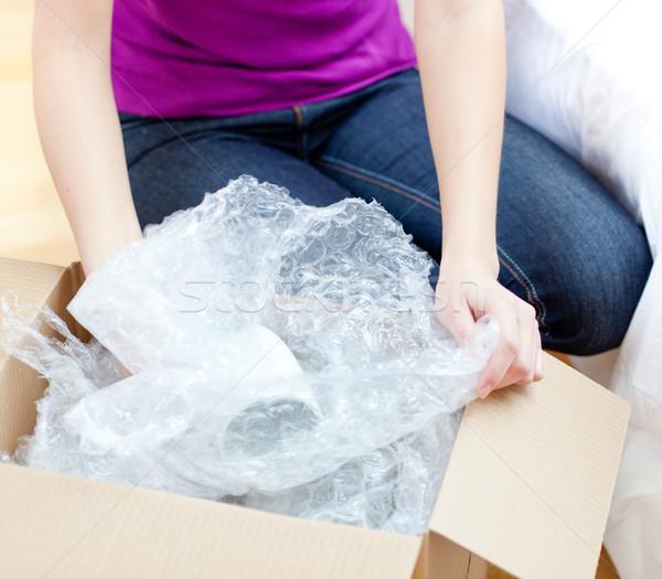 Young woman unpacking box  Stock photo © wavebreak_media