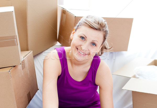 Beautiful woman unpacking box  Stock photo © wavebreak_media