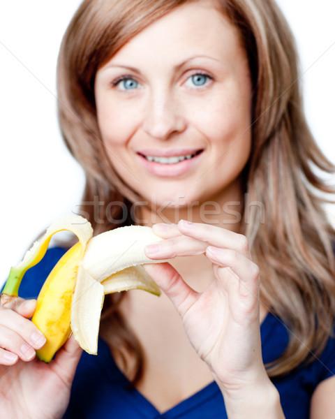 Radiant woman holding a bananna Stock photo © wavebreak_media