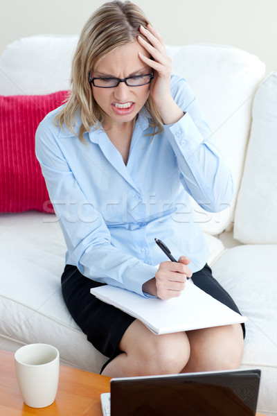 Angry businesswoman sitting on a sofa Stock photo © wavebreak_media